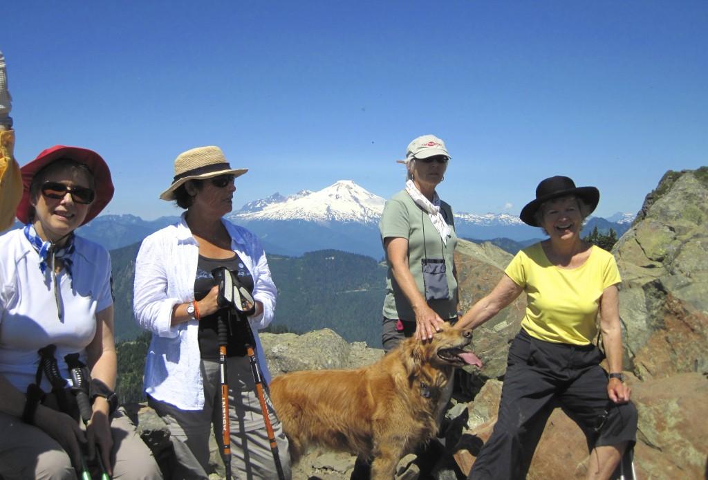 Taking in the view atop Sauk Mountain